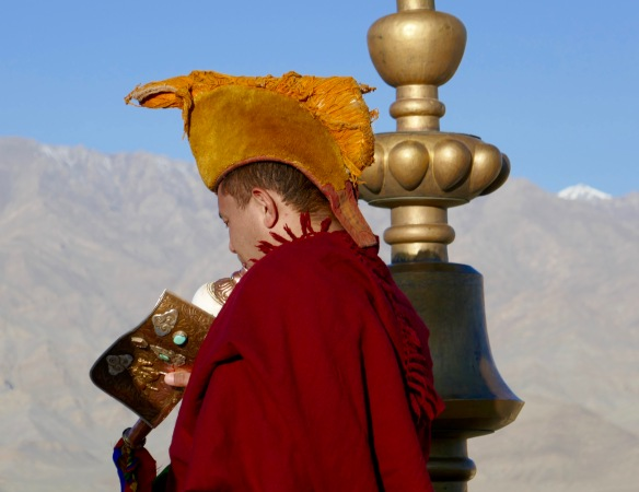 Buddhist Monk calling for prayers